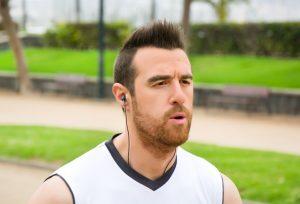 man jogging with headphones