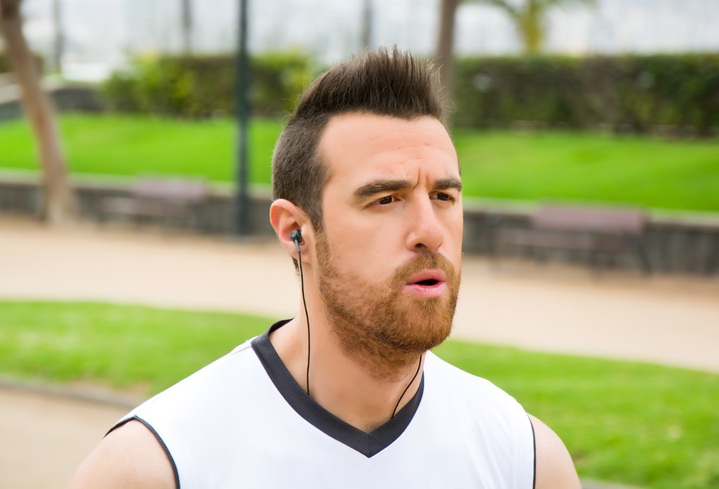 man jogging with headphones